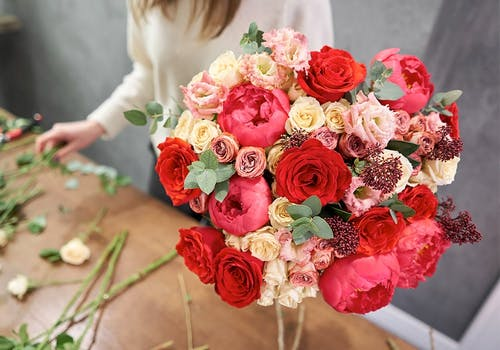 A bundle of red, pink and white roses, fresh from the designer's table