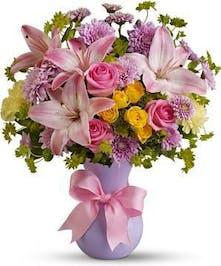 A simple vase of pastel flowers