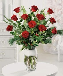 Red Roses elegantly displayed in a glass vase.