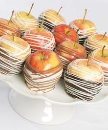 A 1/2 dozen of gourmet dipped apples.
