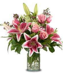 A fragrant mix of stargazer lilies and roses
