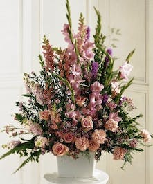 A traditional basket of all pink flowers featuring roses, carnations, liatris, gladiolas, snapdragons, wax flowers, and more.