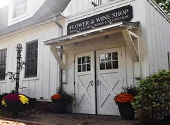 The barn door exterior of our Flower and Wine Shop