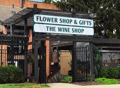 An exterior view of our classic Flower and Wine Shop